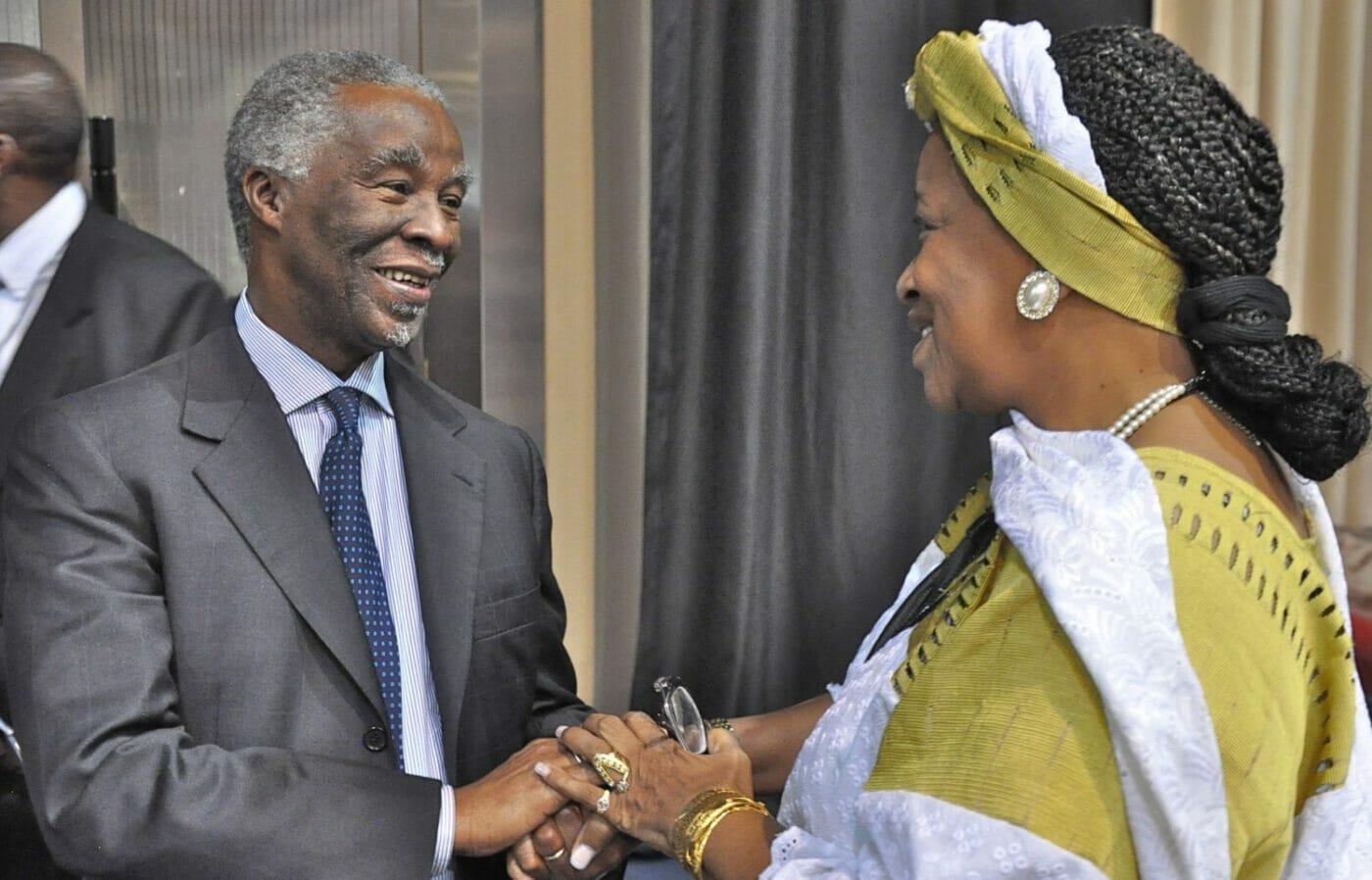 Former South African president Thabo Mbeki shakes hands with Ambassador Bennett