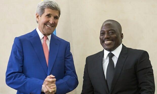 Secretary of State John Kerry, left, poses with DRC's president Joseph Kabila in Kinshasa on May 4, 2014