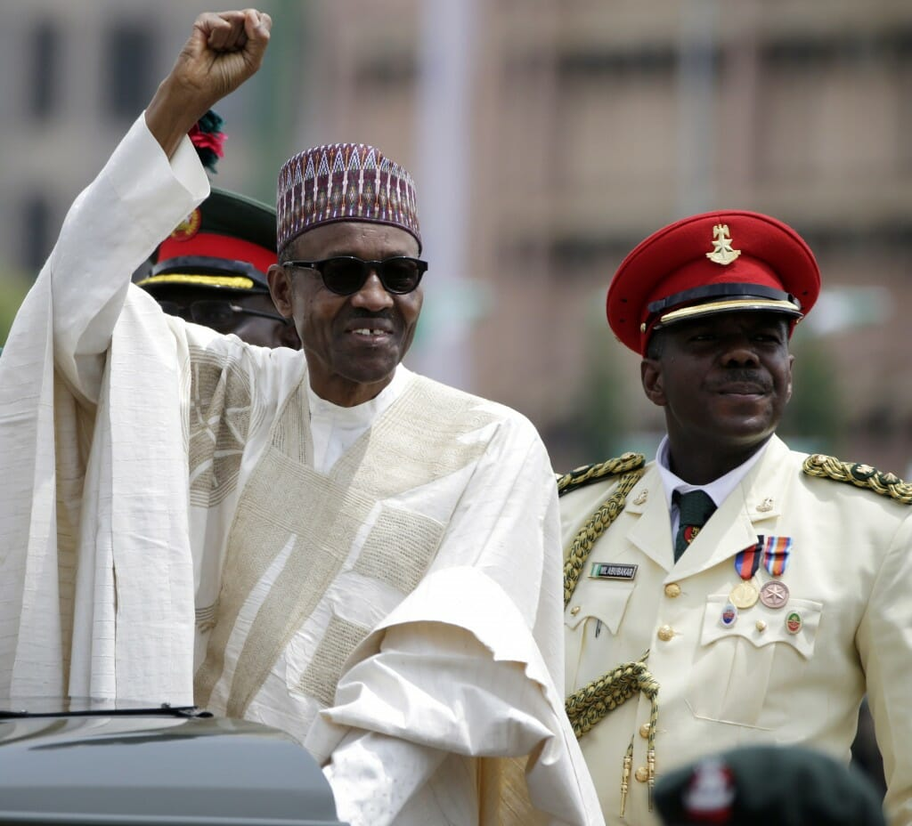 Nigerian President Muhammadu Buhari salutes the crowds during his inauguration on May 29, 2015 (AP Photo/Sunday Alamba)