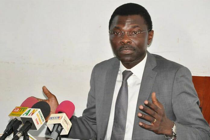 Benin Justice Minister, Joseph Djogbenou, holds a news conference