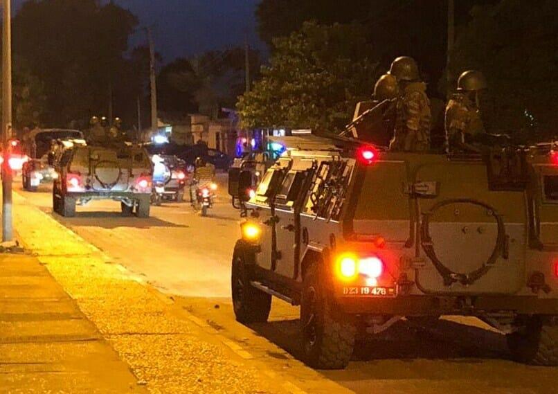 Tanks circulating on the street of Cotonou, Benin's largest city, to intimidate potential agitators